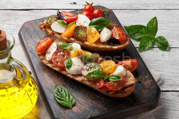 Сток-фото: брускетта · помидоров · моцарелла · базилик · помидоры · черри