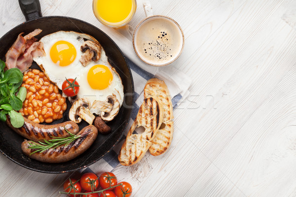 Stock photo: English breakfast. Fried eggs, sausages, bacon