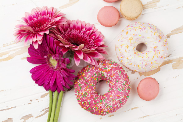 Donuts and gerbera flowers bouquet Stock photo © karandaev