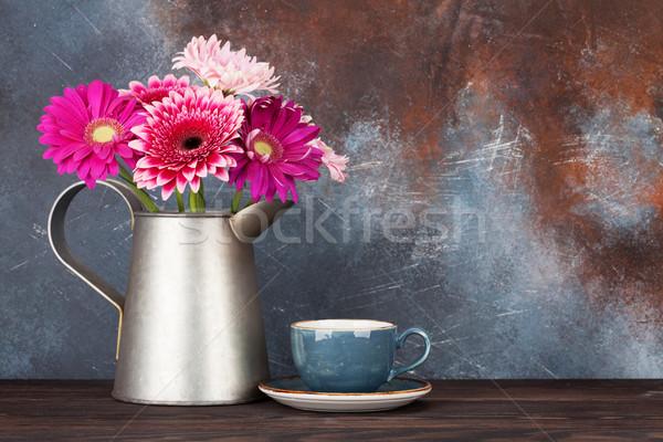 Gerbera flowers bouquet and coffee cup Stock photo © karandaev