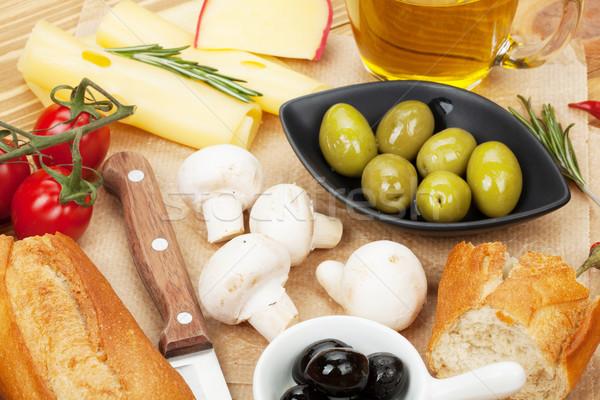 Olives, mushrooms, bread, vegetables and spices Stock photo © karandaev
