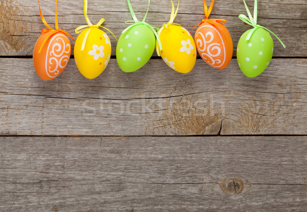 Easter eggs on wooden table background Stock photo © karandaev