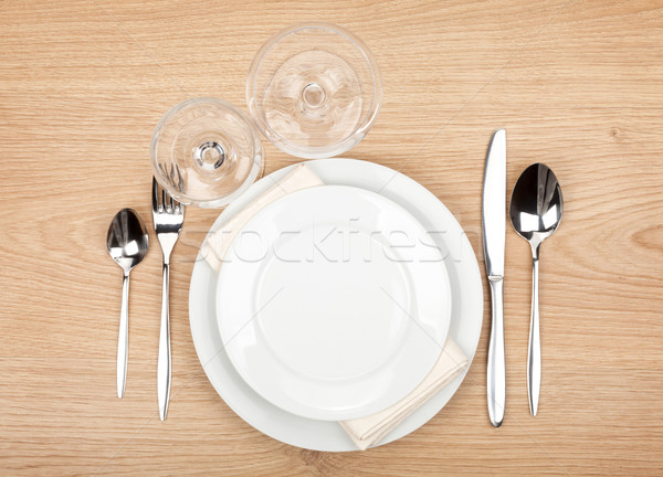 Empty plate, glasses and silverware set Stock photo © karandaev