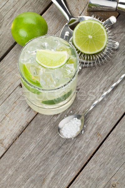 Classic margarita cocktail with salty rim on wooden table Stock photo © karandaev