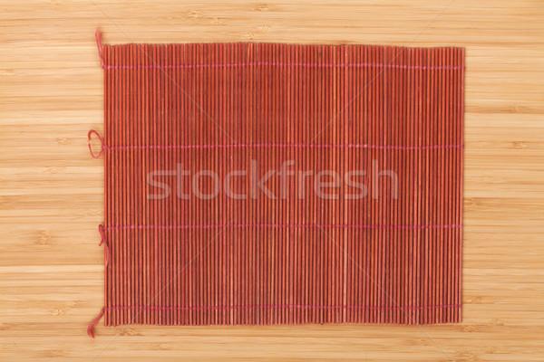 Japanese cooking mat over bamboo table Stock photo © karandaev
