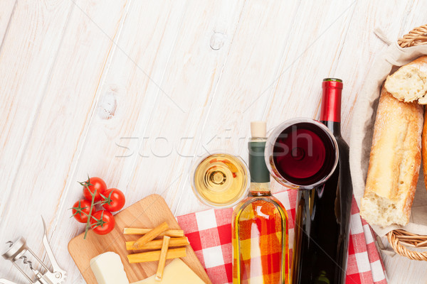 White and red wine, cheese and bread on white wooden table backg Stock photo © karandaev