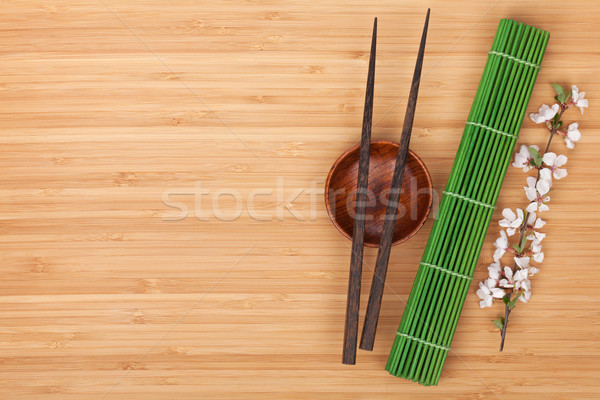 Chopsticks, sakura branch and bamboo mat Stock photo © karandaev