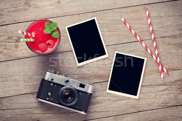 Camera, photo frames and raspberry smoothie Stock photo © karandaev