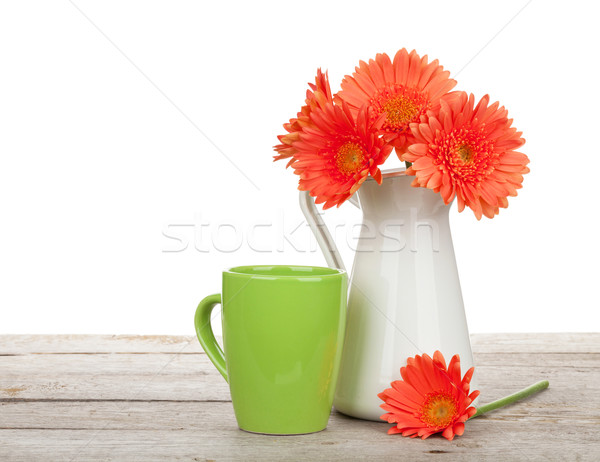 Сток-фото: оранжевый · цветы · Кубок · пить · деревянный · стол · изолированный