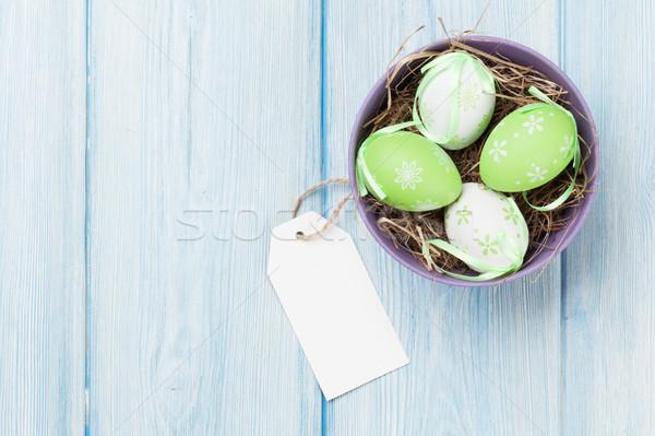 Foto stock: Huevos · de · Pascua · etiqueta · azul · mesa · de · madera · superior · vista