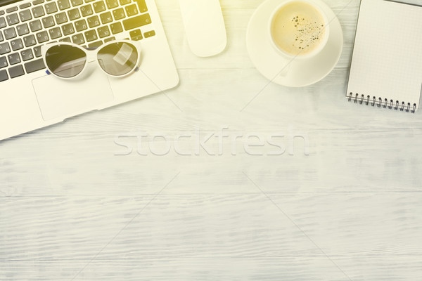 Desk table with laptop, coffee and sunglasses Stock photo © karandaev