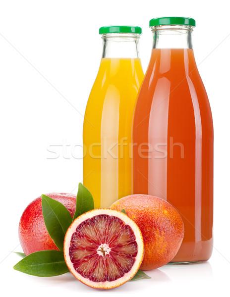 Oranje grapefruit sap flessen geïsoleerd witte Stockfoto © karandaev