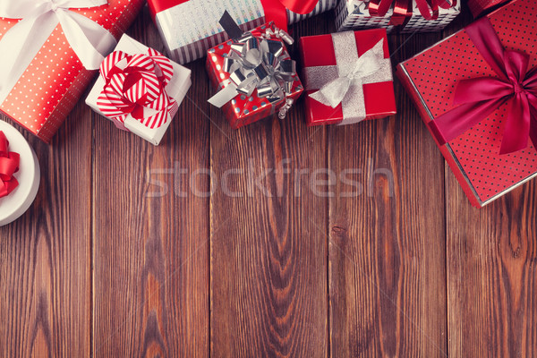 Stock photo: Gift boxes on wooden table