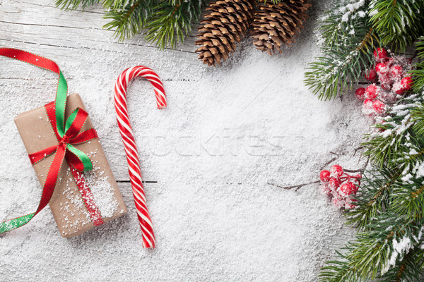 Stock photo: Christmas gift box, candy cane and fir tree