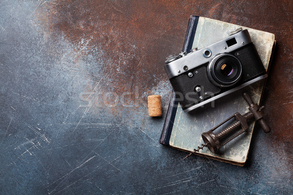 Vintage camera and wine corkscrew Stock photo © karandaev