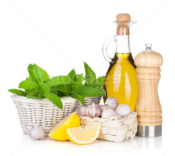 Friss gyógynövények olívaolaj bors shaker izolált Stock fotó © karandaev