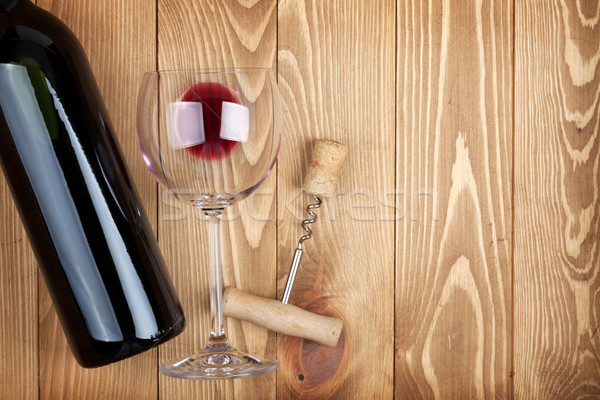 Red wine bottle glass and corkscrew Stock photo © karandaev