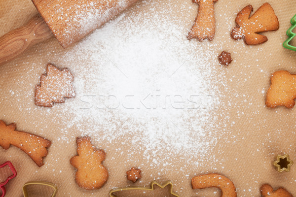 Rolling pin and gingerbread cookies on cooking paper Stock photo © karandaev