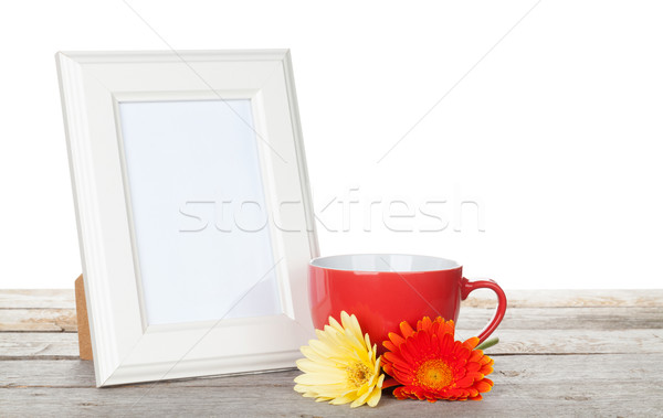 Photo frame with red cup and twocolorful gerbera flowers Stock photo © karandaev