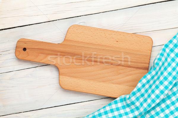 Kitchen utensils over white wooden table background Stock photo © karandaev