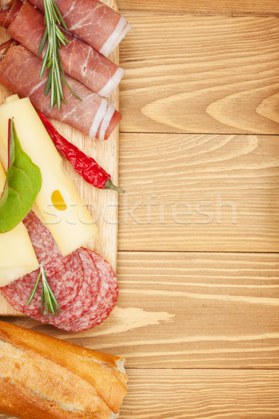 Cheese, prosciutto, bread, vegetables and spices Stock photo © karandaev