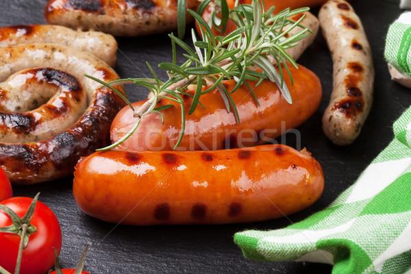 ızgara sosis biberiye domates taş plaka Stok fotoğraf © karandaev