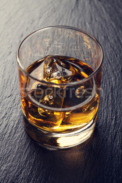 Glass of scotch whiskey with ice Stock photo © karandaev