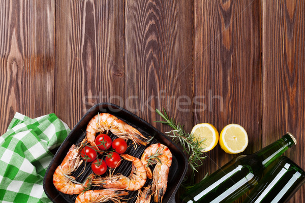 Grilled shrimps on frying pan and beer Stock photo © karandaev