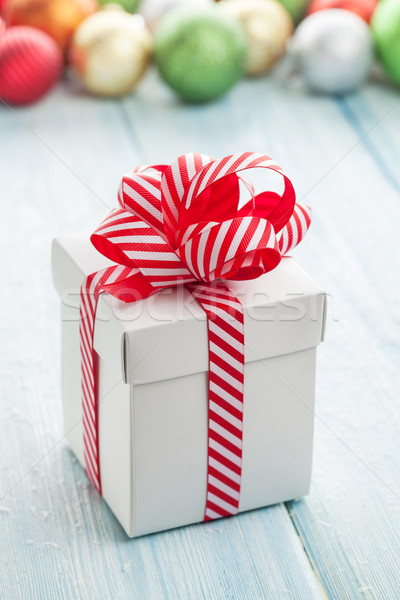 Christmas gift box and colorful baubles Stock photo © karandaev