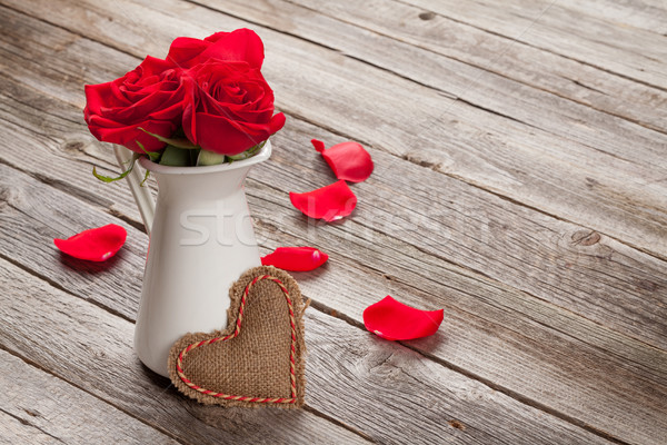 Red rose flowers in pitcher and Valentines day heart Stock photo © karandaev