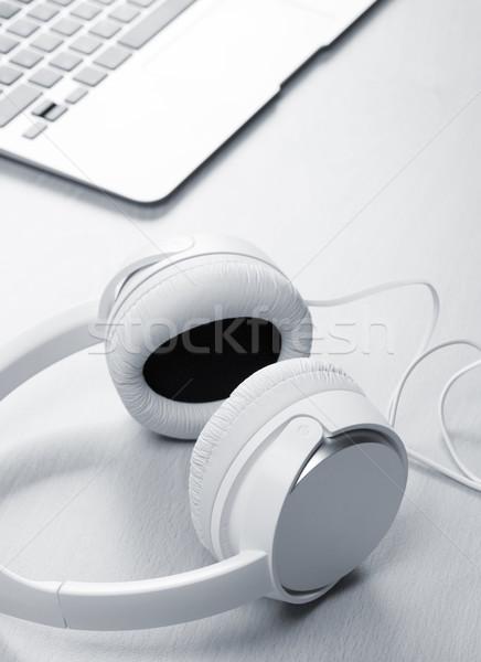 Headphones and laptop on wooden desk table Stock photo © karandaev