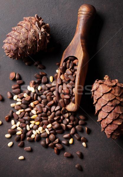 Pine nuts on stone table Stock photo © karandaev