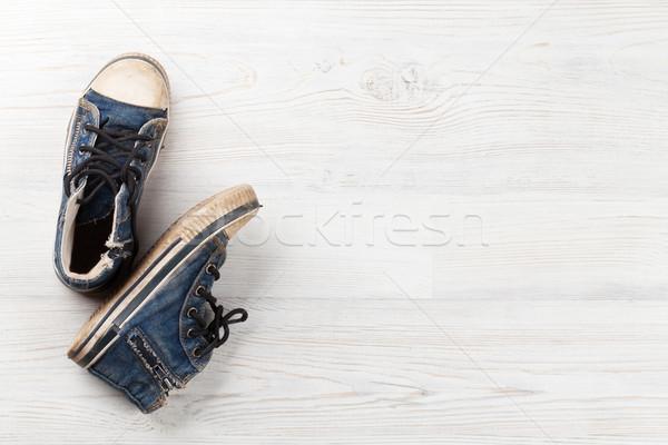 Sneakers on wooden background Stock photo © karandaev