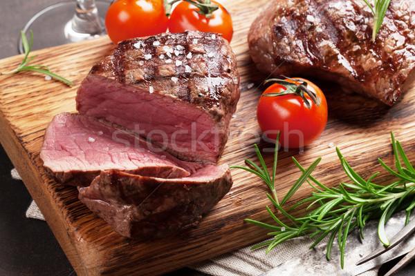 ızgara fileto biftek arka plan kırmızı Stok fotoğraf © karandaev