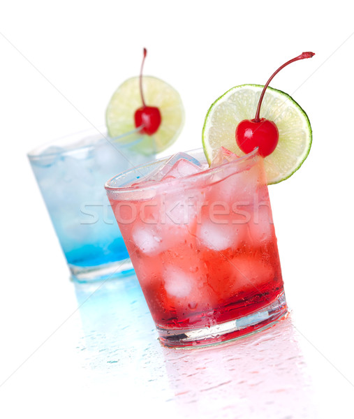 Two cocktails with lime slice and maraschino Stock photo © karandaev