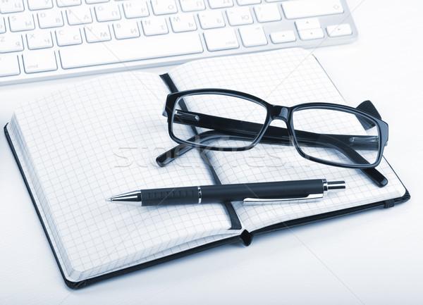 Glasses and office supplies Stock photo © karandaev