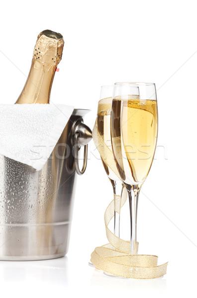 Champagne bottle in ice bucket, two glasses and christmas decor Stock photo © karandaev