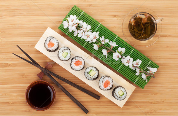 Sushi set tè verde sakura ramo bambù Foto d'archivio © karandaev