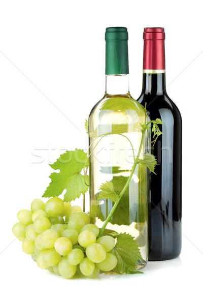 Due vino bottiglie uve isolato bianco Foto d'archivio © karandaev