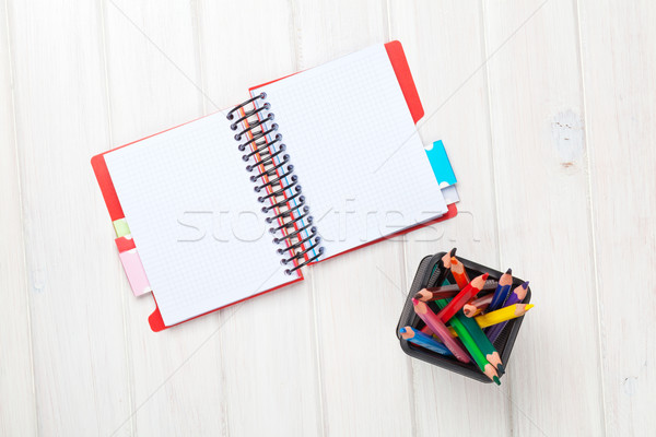 Whtie wooden table blank notepad and colorful pencils Stock photo © karandaev