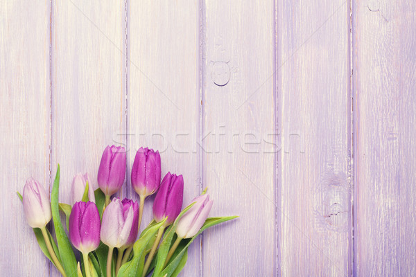 Purple tulip bouquet over wooden table Stock photo © karandaev