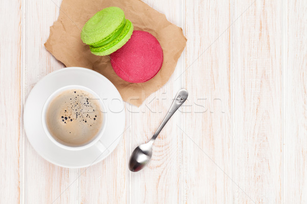 Coffee cup, colorful macarons and spoon Stock photo © karandaev
