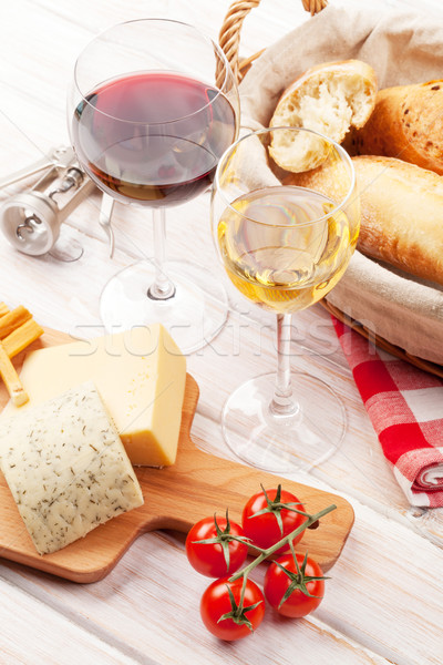 Stock photo: White and red wine, cheese and bread