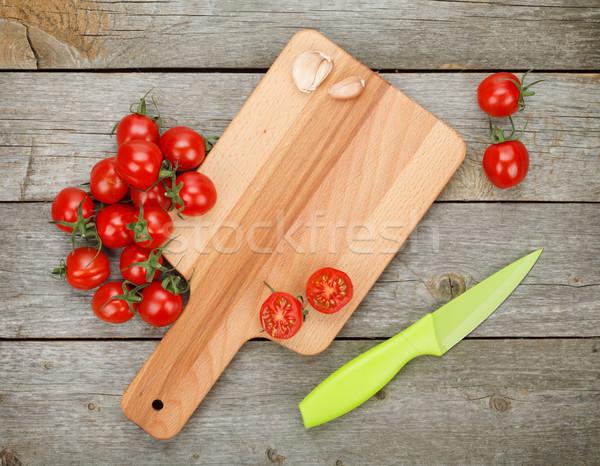 Cherry tomatoes on wooden table Stock photo © karandaev