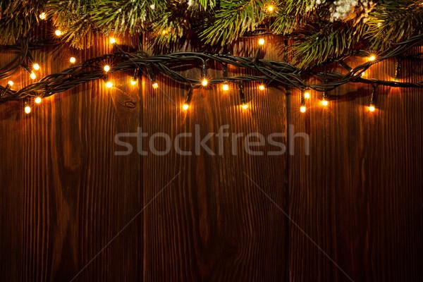 Arbre de noël branche lumières bois vue espace de copie Photo stock © karandaev