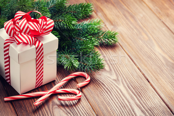 Stock photo: Christmas gift box, candy cane and fir tree branch