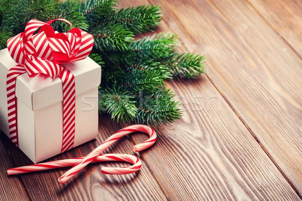 Christmas gift box, candy cane and fir tree branch Stock photo © karandaev