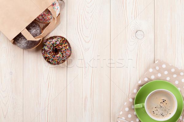 Donuts koffie houten tafel top exemplaar ruimte Stockfoto © karandaev