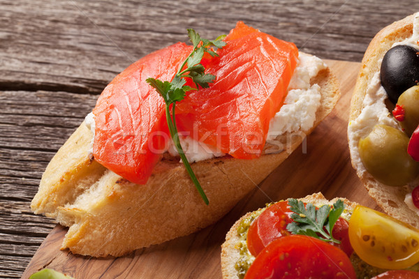 Toast sandwiches with olives, tomatoes, salmon Stock photo © karandaev