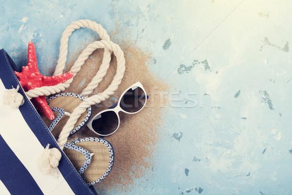 Plage sac lunettes de soleil pierre haut Photo stock © karandaev